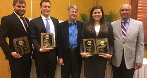 U.S. Tax Court judges Daniel Guy Jr., center, and John Dean, right, present the National Moot Court championship awards to Charleston School of Law's moot court team, Joe Schillizzi, left; Tyler Gilliam, second from left; and Anna Boning, second from right. Photo courtesy Charleston School of Law