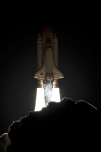 Space Shuttle Discovery lifts off from Kennedy Space Center, Fla., before dawn Monday carrying a seven-member crew led by Navy Capt. Alan G. Poindexter. /NASA/Kenny Allen