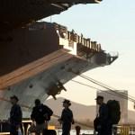 Sailors board the carrier Tuesday. // MC2 James R. Evans / Navy