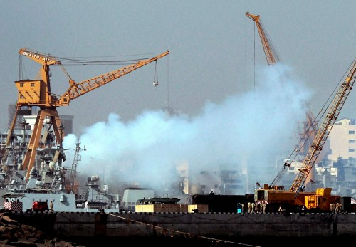 Smoke rises from the Indian frigate Vindhyagiri, which suffered a fire a day after colliding with a cargo ship.