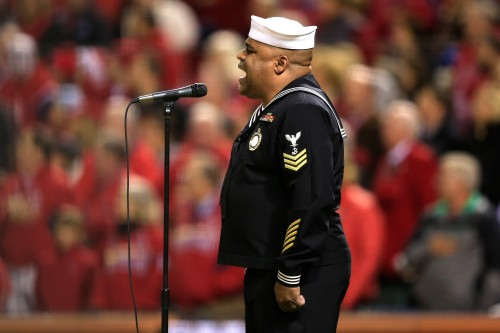 "Retired Navy Counselor 1st Class Generald Wilson sings ""God Bless America"" during Game Three of the 2013 World Series on Saturday at Busch Stadium in St. Louis."