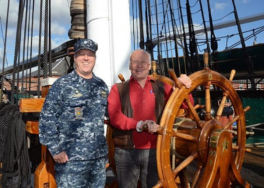 CHARLESTOWN, Mass. (Oct. 18, 2013) Buzz Aldrin, retired NASA astronaut and U.S. Air Force Col., poses for a photo at the helm of USS Constitution with Cmdr. Sean Kearns, Constitution's 73rd commanding officer, during a tour of 'Old Ironsides'. Aldrin, the second person to ever walk on the surface of the moon, was the lunar module pilot on the Apollo 11 moon landing mission on July 21, 1969. (U.S. Navy photo by Mass Communication Specialist 2nd Class Peter D. Melkus/Released)
