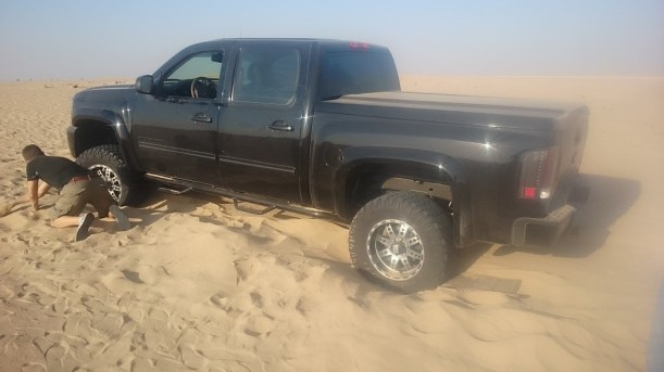 truck in the sand photo 1