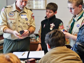 You might not expect rocks to be involved in an event focused on math, science, and technology. But this New Hampshire gathering exposes Scouts to nontraditional topics such as geology (below). Jim Frey, assistant Scoutmaster of Troop 28 in Dunstable, Mass., uses his college degree in geological engineering to discuss rock types with Scouts. (Photo courtesy of Debbie Hill.)