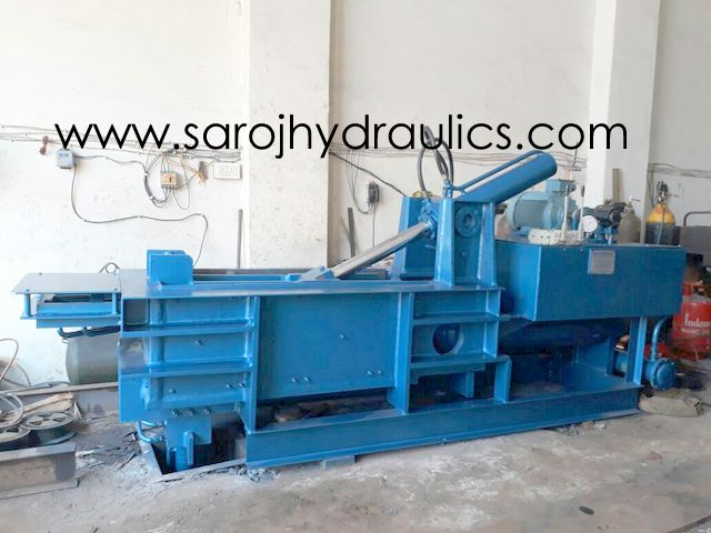 double action baling machine with ejector