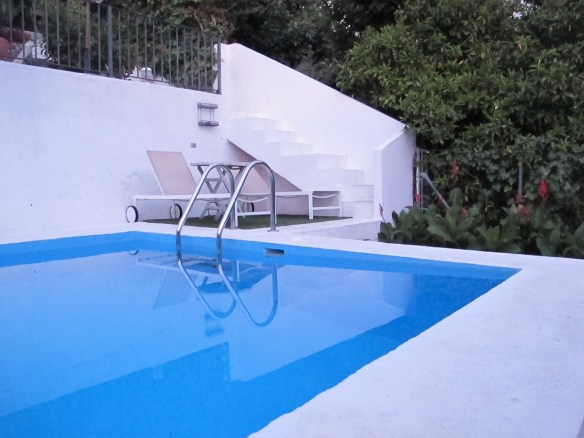 Pool with sunloungers.
