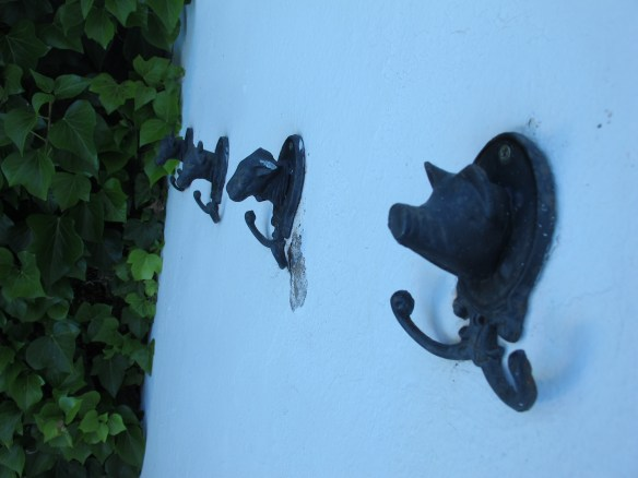 Quirky personal touches make the house feel homely - we loved these animal towel hooks by the pool.