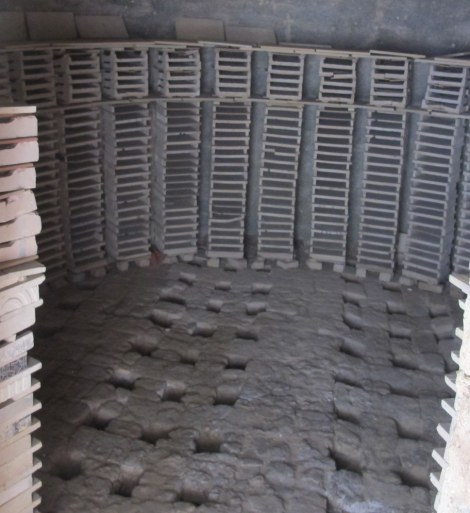 An oven with shelves inside, so that each tile is fired without touching another.