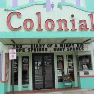 Purple, green, red building houses the Colonial Theatre.