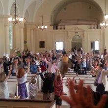 Children's choir leading the congregation