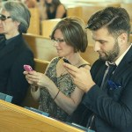 People check their photos on their phones