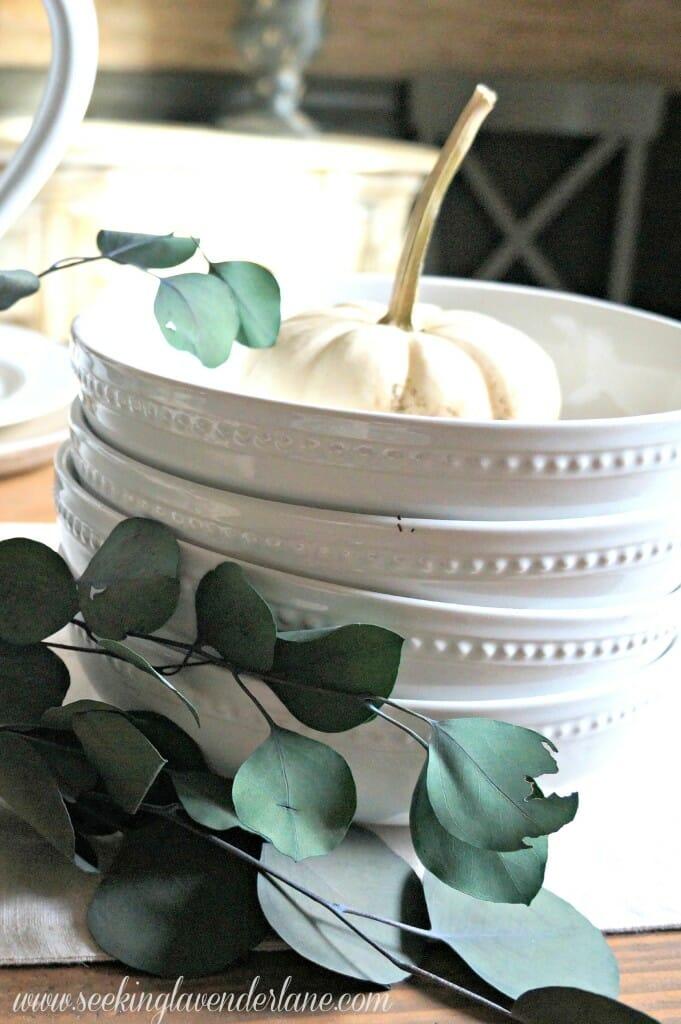 White dishes and eucalyptus