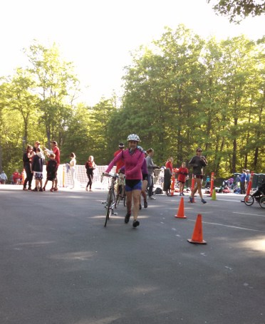 My buddy Lori came to check out the hullabaloo and snapped this photo of my exiting the transition area.