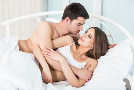 Loving couple in bed.