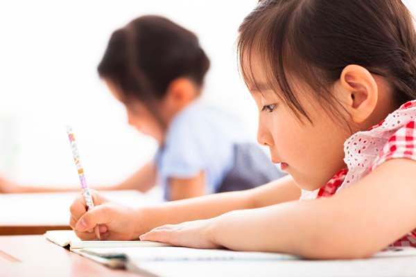 happy children study in the classroom