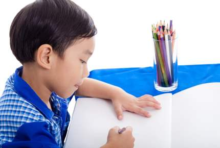 Boy drawing picture