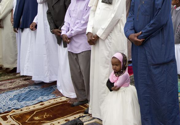 A Muslim child joins Kenyan Muslims as they offer Eid al-Fitr prayers in open grounds in Nairobi, Kenya, Sunday, June 25, 2017, to mark the end of the month of Ramadan. (AP Photo/Sayyid Abdul Azim)