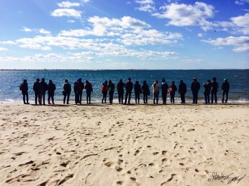 Sentinels gather at the shore to learn about coastal erosion.
