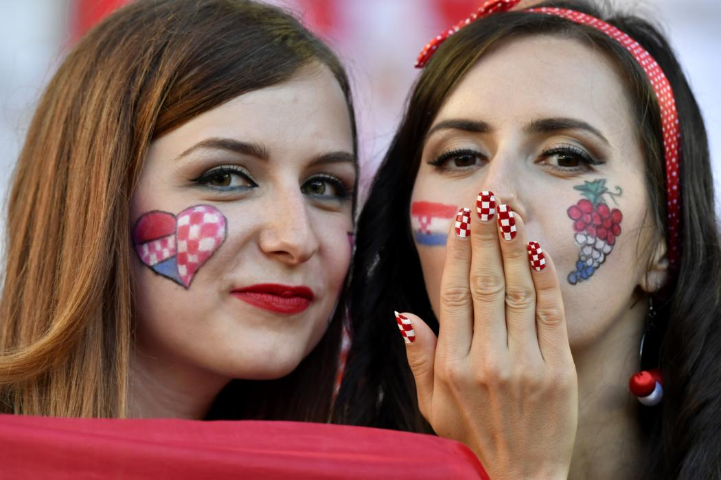 Croatia supporters pose for a picture during the Euro 2016 group D football match between Croatia and Spain at at the Matmut Atlantique stadium in Bordeaux on June 21, 2016. / AFP PHOTO / Georges GOBET
