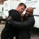 Michael Beach on set with Chris Hemsworth during the filming of Red Dawn (2012).