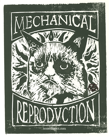 "Woodcut print, ""Benjaminian Grumpy Cat: Mechanical Reproduction,"" from choice pine woodblock and on Antique Laid cotton blend paper."
