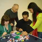 A team working on one of the tasks used in the study. Teams were asked to assemble complicated Lego® structures based on detailed instructions. Teams were randomly assembled by soliciting participation via Craig's List. Credit: MIT