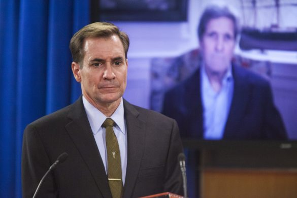 WASHINGTON, USA - JUNE 16: U.S. State Department Spokesperson John Kirby listens as Secretary of State John Kerry answers question via video teleconference from Massachusetts during the daily press briefing at the State Department in Washington, USA on June 16, 2015. (Samuel Corum - Anadolu Agency)