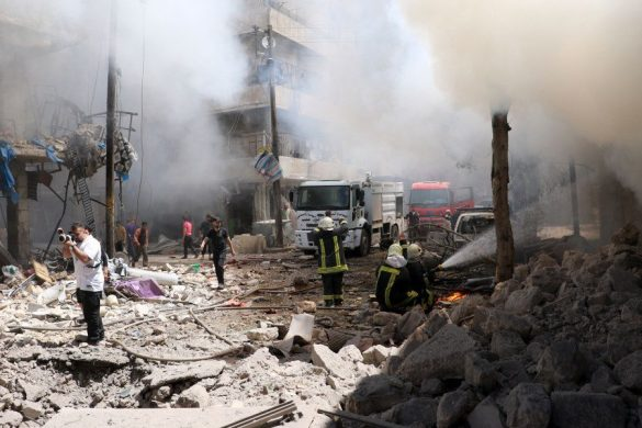 ALEPPO, SYRIA - JUNE 8: Smoke rises over the wreckage of buildings after a helicopter belonging to the Syrian army carried out barrel bomb attacks on Beyan hospital and a bazaar in Aleppo, Syria on June 8, 2016.  ( Ibrahim Ebu Leys - Anadolu Agency )