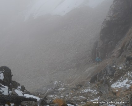 Then the clouds came in during the last ~100m of ascent which was mostly scrambling on loose rock. Can you spot Sudeep?
