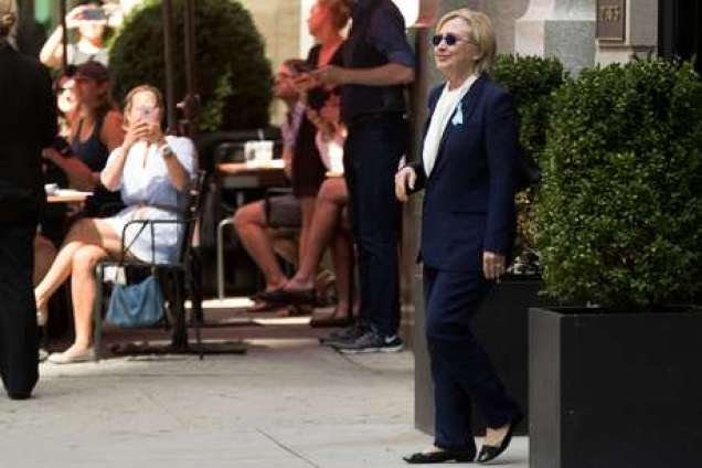 """Democratic presidential candidate Hillary Clinton leaves an apartment building Sunday, Sept. 11, 2016, in New York. Clinton's campaign said the Democratic presidential nominee left the 9/11 anniversary ceremony in New York early after feeling """"overheated."""" (AP Photo/Andrew Harnik)"""