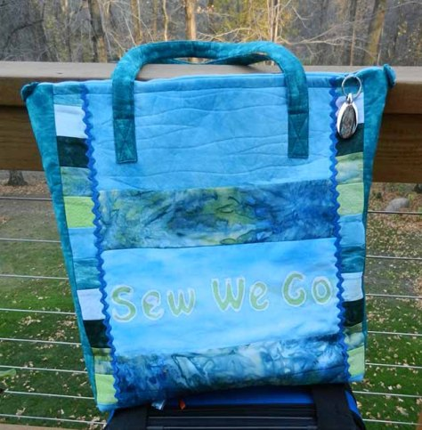 """by Chris Kirsch - """"I also made a tote. The fabric was mixed with many others is a tote pattern designed by a mutual friend, Kathy Frye. I used Wendy's faux batik method to create the words """"Sew We Go"""" for the front pocket of the bag."""""""