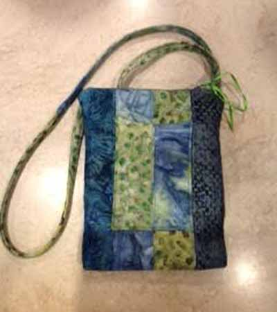 """by Lisa Giesfeldt - Lisa made this small purse and said she """"even used the ribbon that was wrapped around the fabric.  It's my zipper pull. The color worked with my batik choices."""""""