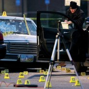 Tim Russell's car was surrounded by dozens of police evidence markers indicating bullets, shells or other pieces of evidence. – Photo: Marvin Fong, Cleveland Plain Dealer