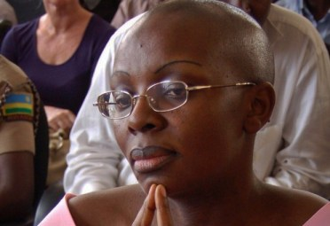 Victoire Ingabire in court fingers to chin