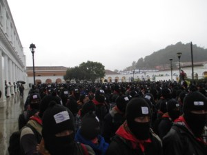 Zapatistas march in San Cristobal, Chiapas, in rain 122112 by EZLN News