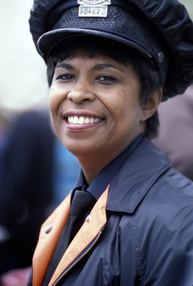 Black woman cop smiling