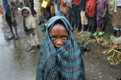 Drenched Congolese child Kibati, north of Goma, eastern Congo 080812 by Jerome Delay, AP