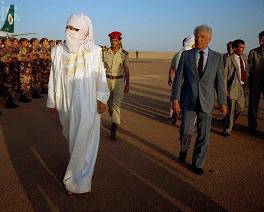 Muammar Qaddafi inspects troops wearing traditional Tuareg dress