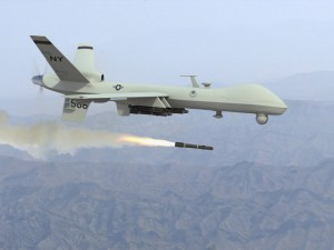 Unmanned predator drone fires missile
