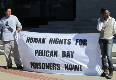 Assembly hearing on SHUs 'Human rights for Pelican Bay prisoners now!' banner at rally 022513 by Denise Mewbourne