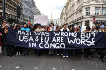 Congolese demonstrate 'Nazi was wrong but USA & EU are worse in Congo' banner