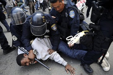 May Day General Strike young Black man on ground tasered dntn Oakland 050112 by Michael Short, Special to Chron