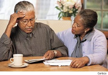 Older Black couple ponder Alzheimer's by Corbis
