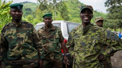 M23 military leader Gen. Sultani Makenga, rt, w troops near Sake, DRC 1112