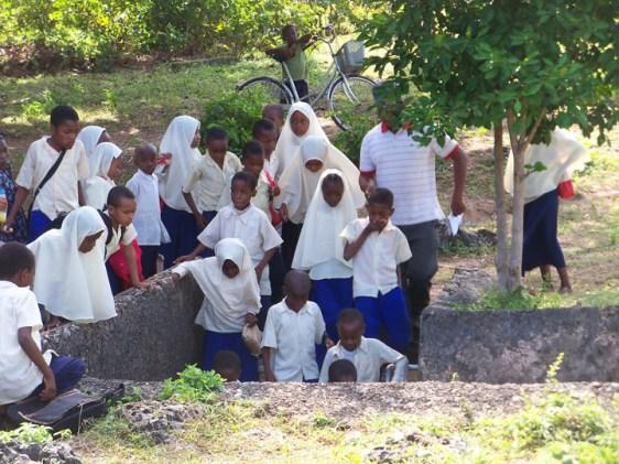 Mangapwani Slave Cave school children descend into cave 0713 by Wanda