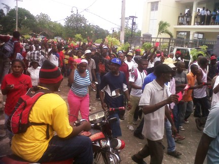 Anti-Martelly, pro-Aristide march red cards on 21st anniversary of 1991 coup against Lavalas 093012, web