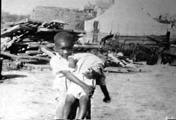 Tulsa Race Riot, Black Wall Street child carrying child 060121