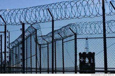 Folsom Prison periphery modern razor wire, electric fence, 1880 tower 110707 by Lucy Atkins, SF Chron