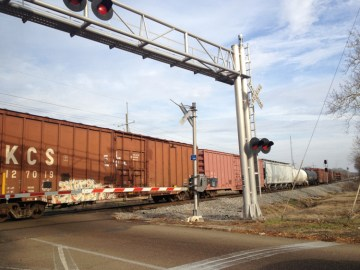 Train at railroad crossing, Jackson, Miss