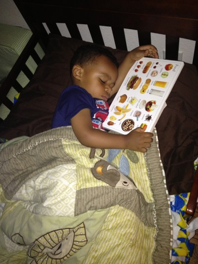 Morris Turner's grandson, Marcelo, 2, with his favorite book